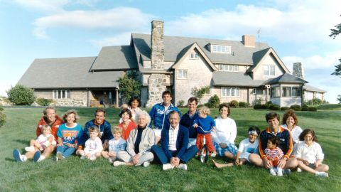 Members of the Bush family pose for a 1986 photo in Kennebunkport, Maine. George W. Bush is third from left behind his young daughter Barbara.