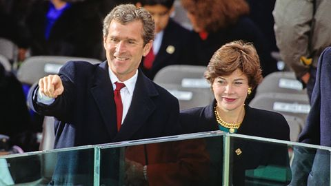 Bush and his wife, Laura, attend his father's inauguration in 1989. Bush worked on his father's presidential campaign.