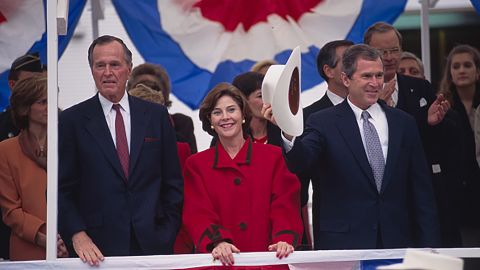 Bush's father joins him and Laura at his inauguration in Texas in 1994. Bush went on to win a second term in 1998 before running for president.