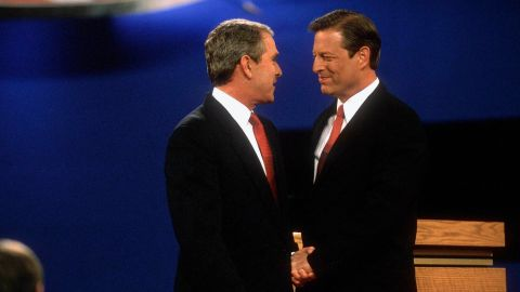 Bush shakes hands with his Democratic opponent, Vice President Al Gore, at their first presidential debate in October 2000.