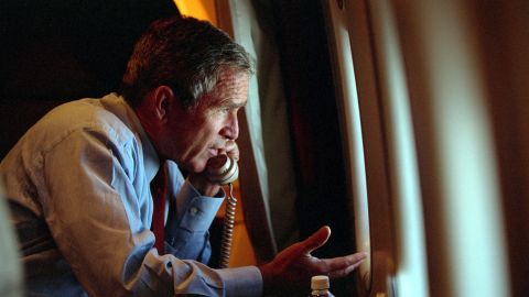 Bush, aboard Air Force One, talks on the phone with Vice President Dick Cheney on September 11, 2001.