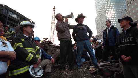 Bush speaks to rescue workers, firefighters and police officers at the rubble of New York's ground zero, three days after the September 11 attacks.