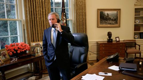 Bush takes a phone call from Kerry, who was conceding the 2004 election.