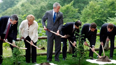 Bush and other world leaders plant a memorial tree after a working session at the G8 summit in Toyako, Japan, in June 2008.