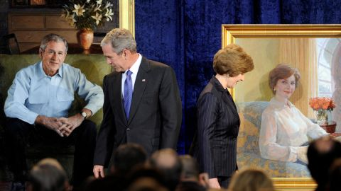 Bush and his wife, Laura, look over their portraits during their unveiling at the National Portrait Gallery in December 2008.