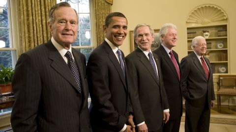 Bush poses with President-elect Barack Obama and three former presidents in the White House Oval Office in January 2009.