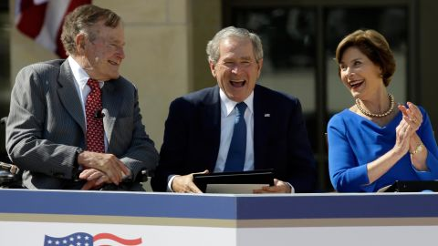 Bush, his wife and his father attend the dedication of his presidential library near Dallas in 2013.
