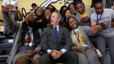 Bush poses with students at a New Orleans high school in 2015. He was in town for the 10th anniversary of Hurricane Katrina.
