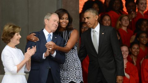 First lady Michelle Obama embraces Bush at the dedication of the National Museum of African American History and Culture in 2016.