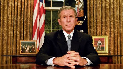 """Bush prepares to address the nation on the evening of September 11. """"Terrorist attacks can shake the foundations of our biggest buildings, but they cannot touch the foundation of America,"""" he said in his remarks. """"These acts shatter steel, but they cannot dent the steel of American resolve."""""""
