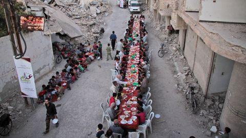 Residents of the war-torn city of Douma break their Ramadan fast on June 18, 2017.