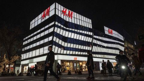BEIJING, CHINA - MARCH 25: People walk by the flagship store of clothing brand H&M at a shopping area on March 25, 2021 in Beijing, China. Many on Chinese social networking platforms called for boycotts of major Western brands, including H&M, after statements made by the companies in the past about Xinjiang cotton resurfaced online. (Photo by Kevin Frayer/Getty Images)
