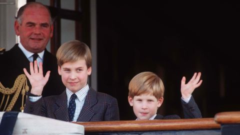 Prince William and Prince Harry wave from the deck of the Royal Yacht Britannia in 1991.