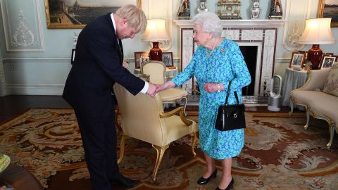 """The Queen welcomes Boris Johnson at Buckingham Palace, where she formally invited him to become Prime Minister in July 2019. Johnson <a href=""""https://edition.cnn.com/2019/07/23/uk/boris-johnson-prime-minister-uk-gbr-intl/index.html"""" target=""""_blank"""">won the UK's Conservative Party leadership contest</a> and replaced Theresa May, who was forced into resigning after members of her Cabinet lost confidence in her inability to secure the UK's departure from the European Union."""