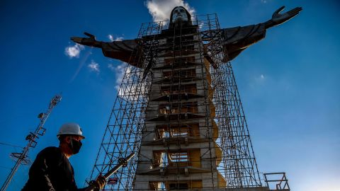 A worker is seen in front of a Christ statue being built in Encantado, Rio Grande do Sul state, Brazil, on April 09, 2021. - The Christ the Protector statue under construction in Encantado will be larger than Rio de Janeiro's Christ the Redeemer and the third-largest in the world. (Photo by SILVIO AVILA / AFP) (Photo by SILVIO AVILA/AFP via Getty Images)