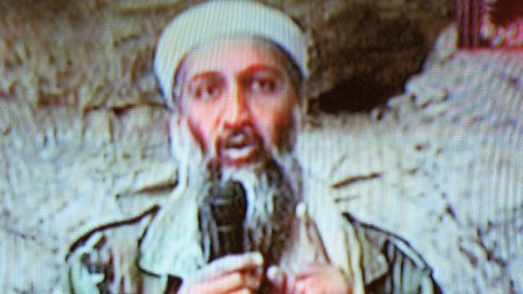 """Al Qaeda leader Osama bin Laden is seen at an undisclosed location in this television image broadcast on October 7, 2001. Bin Laden praised God for the September 11 attacks and swore America """"will never dream of security"""" until """"the infidel's armies leave the land of Muhammad."""""""