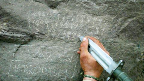 US soldier Jorge Avino tallies the number of people that his mortar team had killed while fighting in Afghanistan in March 2002.