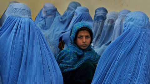 Women wait in line to be treated at a health clinic in Kalakan, Afghanistan, in February 2003.