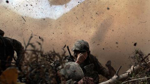 US soldiers shield their eyes from the rotor wash of a Chinook helicopter as they are picked up from a mission in Afghanistan's Paktika province in October 2009.
