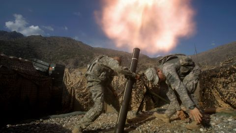 US soldiers fire mortars from a base in Afghanistan's Kunar province in October 2009.