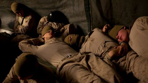 Troops rest at an airfield in Afghanistan's Helmand province in February 2010.