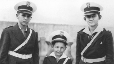 Castro, center, poses for a photo with his brothers Fidel, left, and Ramon, right, in Santiago de Cuba around 1940.