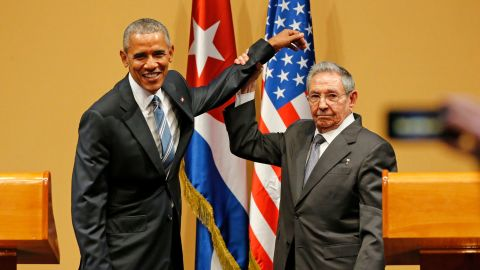 Castro lifts US President Barack Obama's arm after delivering speeches at the Palacio de la Revolución in Havana in 2016. The salute came at the end of a contentious press conference in which members of the press peppered Castro with questions about human rights abuses in the country. Obama was the first sitting US President to visit Cuba since Calvin Coolidge's visit in 1928.