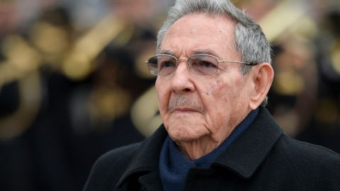 Cuba's president Raul Castro observes a welcoming ceremony at the Arc de Triomphe in Paris in 2016.