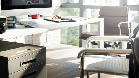 Whenever possible, find ways to make use of the empty surfaces in your office, whether it's the sides of walls and cabinets or the underside of your desk.