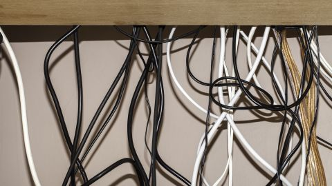 You can bundle that mess of cords together with some simple cable ties.