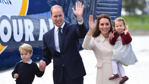 """Charlotte is held by her mother as her family ends <a href=""""http://www.cnn.com/2016/09/24/world/gallery/royals-visit-canada-sept-2016/index.html"""" target=""""_blank"""">an eight-day tour of Canada</a> in October 2016. At left is her brother and her father."""