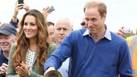 William and Catherine start an ultra marathon in Holyhead, Wales, in August 2013. It was Catherine's first public appearance since the birth of Prince George.