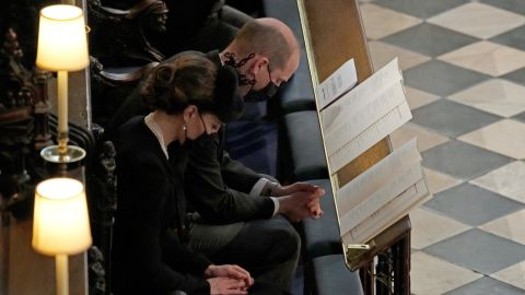 """William and Kate attend the <a href=""""http://www.cnn.com/2021/04/17/uk/gallery/prince-philip-funeral/index.html"""" target=""""_blank"""">funeral service</a> of William's grandfather, Prince Philip, inside St. George's Chapel in Windsor Castle, on April 17."""