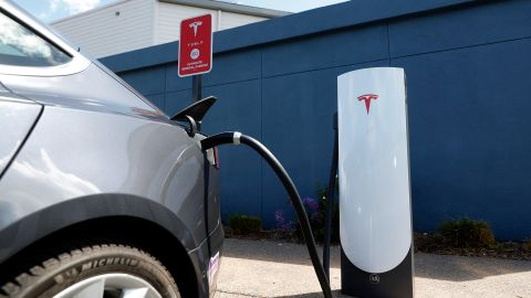 A Tesla car charges at a Tesla Supercharger station on April 26, 2021 in Corte Madera, California. Tesla will report first quarter earnings today after the closing bell. (Photo by Justin Sullivan/Getty Images)