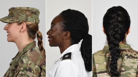 US soldiers wearing new approved ponytail styles.