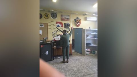 """The complaint read the pilot was forced to inflate and wear an inflatable maritime overflight outfit, raise his arms and stand as a """"human clock."""""""