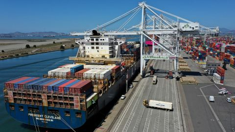 OAKLAND, CALIFORNIA - MAY 07: In an aerial view, an container ship is unloaded at the Port of Oakland on May 07, 2021 in Oakland, California. The Port of Oakland reported a record high in cargo traffic volume between January and March of this year with 631,119 20-foot shipping containers compared to 612,151 set in the first quarter of 2019. (Photo by Justin Sullivan/Getty Images)