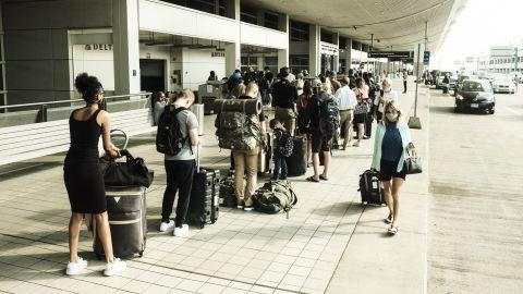 Travelers arrive at the Detroit Metropolitan Wayne County Airport (DTX) in Romulus, Michigan, on Saturday, June 12, 2021.