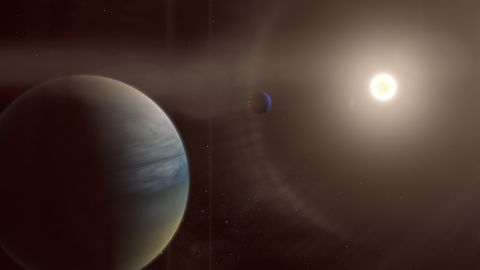 In this artist's illustration, two gaseous exoplanets can be seen orbiting the bright sun-like star HD 152843.