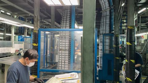 Printing presses of Hong Kong's Apple Daily newspaper print the final edition in the predawn hours.