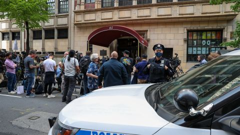 """Members of the press gather outside Giuliani's apartment in New York in April 2021. Federal agents <a href=""""https://www.cnn.com/2021/04/28/politics/rudy-giuliani-federal-prosecutors/index.html"""" target=""""_blank"""">executed search warrants</a> at Giuliani's apartment and office, his attorney said, advancing a criminal investigation by federal prosecutors that has been underway for more than two years. Giuliani has been the focus of an investigation concerning his activities in Ukraine, including whether he conducted illegal lobbying for Ukrainian officials while he pursued an investigation linked to Trump's primary political rival, President Joe Biden, CNN has reported. Giuliani hasn't been charged, and he has denied wrongdoing."""