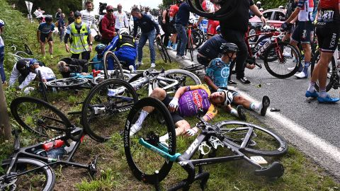 Bryan Coquard of France and Team B&B Hotels p/b KTM & Kristian Sbaragli of Italy and Team Alpecin-Fenix wait for medical assistance after a crash during the 108th Tour de France 2021, Stage 1 a 197,8km stage from Brest to Landerneau.