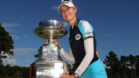 JOHNS CREEK, GEORGIA - JUNE 27: Nelly Korda poses with the trophy after putting in to win on the 18th green during the final round of the KPMG Women's PGA Championship at Atlanta Athletic Club on June 27, 2021 in Johns Creek, Georgia. (Photo by Kevin C. Cox/Getty Images)