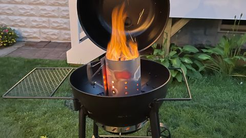 RapidFire Chimney Starter inside a charcoal grill.