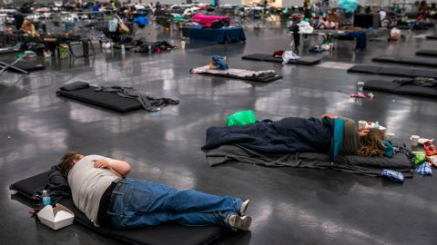 People rest at a cooling center that was set up at the Oregon Convention Center in Portland on Sunday.