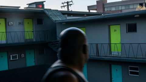 Everett Clayton looks at a digital thermometer that reads 116 degrees while walking to his apartment in Everett, Washington, on Sunday.