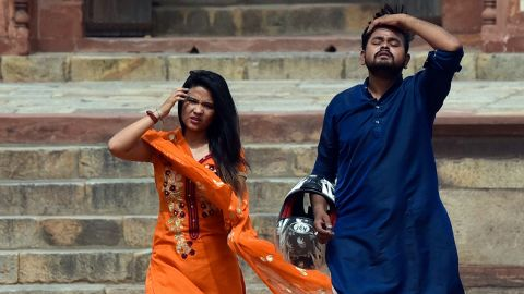 Visitors at Humayun's Tomb in New Delhi, India, on a hot day on June 30 amid a heatwave.