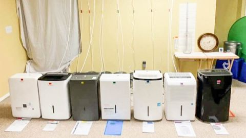 All the tested dehumidifiers set up for our pump hose test.