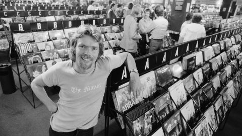 Branson poses in one of his Virgin Megastores in 1979. His mail-order record business had evolved into a chain of successful record stores. By this time, Branson also had started his Virgin Records music label. Over the years, Virgin would sign notable artists such as the Sex Pistols, the Rolling Stones and Genesis.
