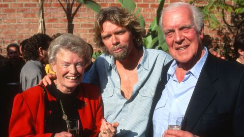 Branson poses with his parents, Eve and Edward, at a reception in Los Angeles in 1991. His mother was a flight attendant and his father was a lawyer.